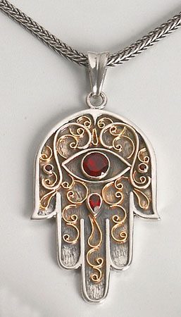 gold and ruby hamsa pendant